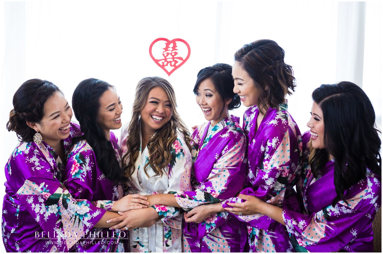 Bride and her bridesmaids get ready for the wedding in silk robes