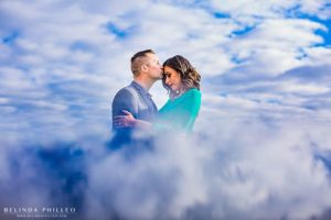 Romantic cloud reflection engagement photo in downtown santa ana. photography by Belinda Philleo