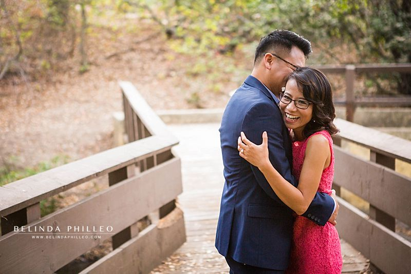 Couple having fun during their Oak Canyon Nature Center engagement photos by Belinda Philleo