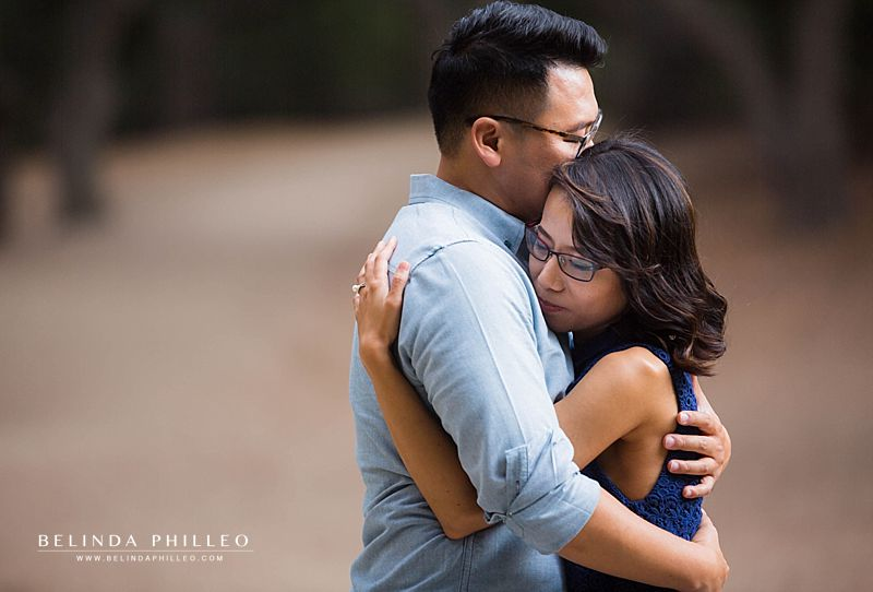 Couple shares a tender hug during their Oak Canyon Nature Center engagement photos by Belinda Philleo