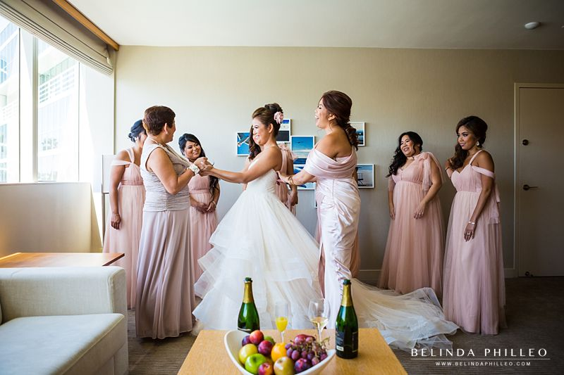 Bridesmaid's help the bride get ready for her wedding at the Hyatt Regency Long Beach, CA
