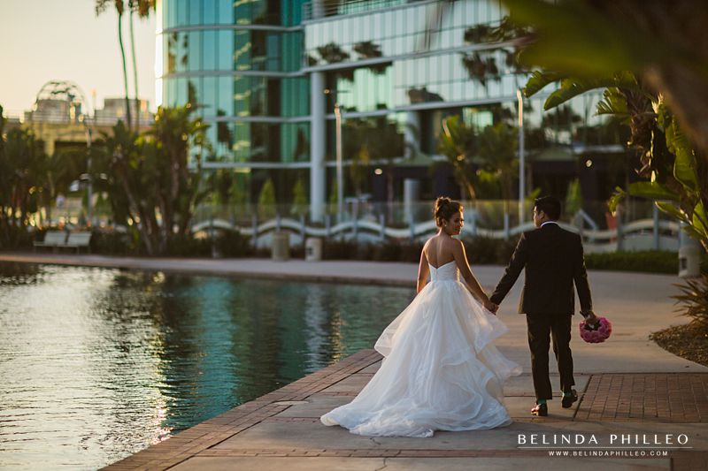 Bride and groom make their way to their reception at the Hyatt Regency Long Beach, CA