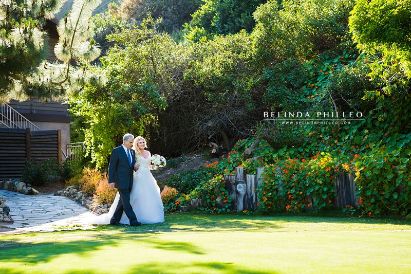Bride is walked down the aisle at The Ranch at Laguna