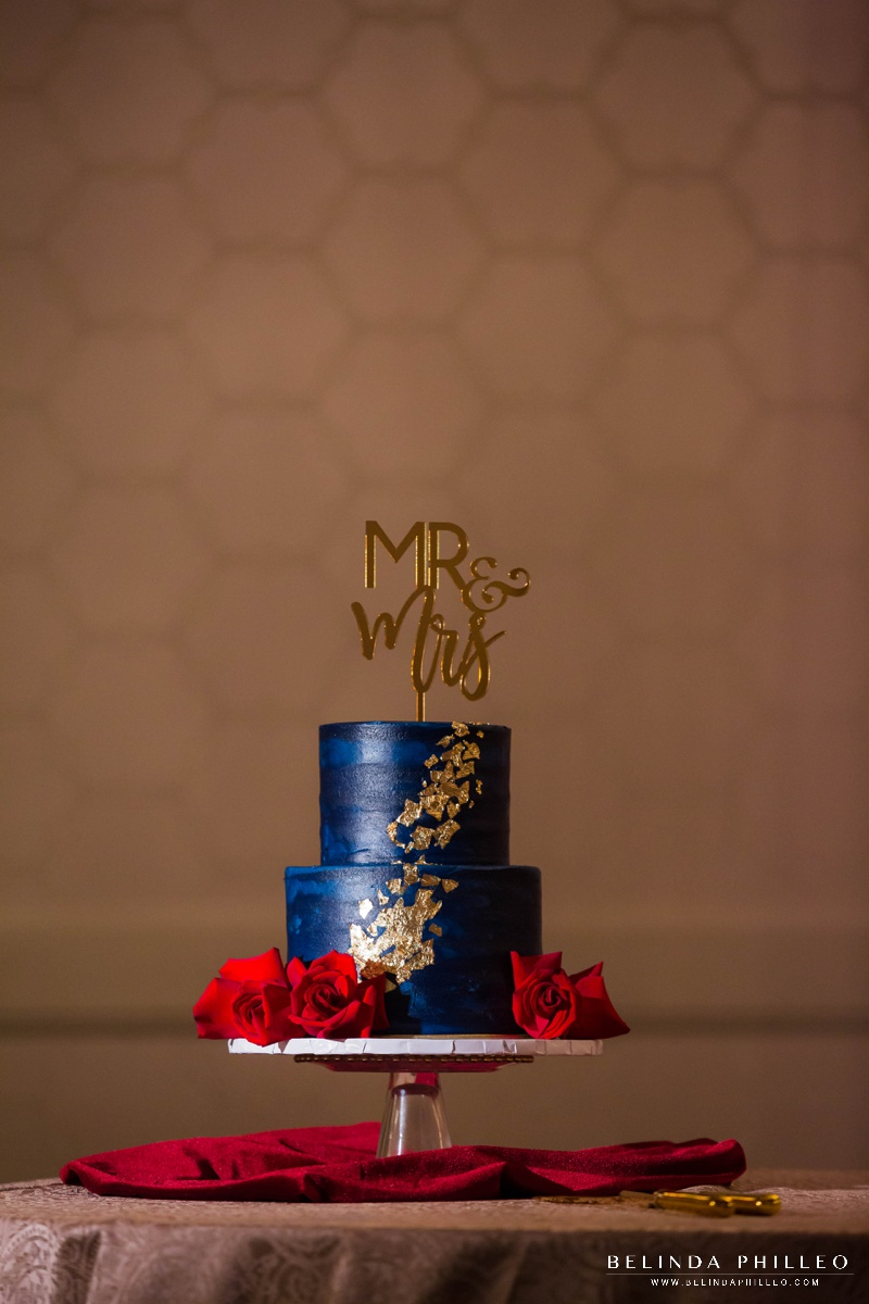 Navy blue and gold wedding cake with gold acrylic Mr & Mrs cake topper sign