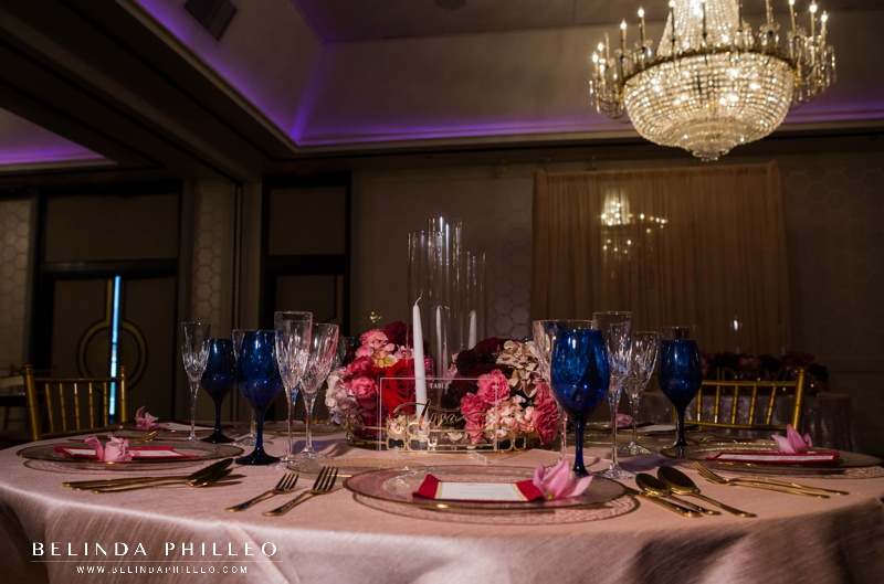 Blush, gold, navy and merlot reception decor at the Hills Hotel Laguna