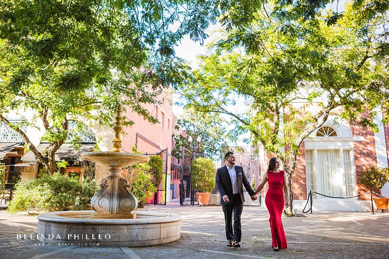 Engagement Session Locations in Orange County. A couple in formal attire takes a stroll down 2nd Street in Santa Ana during their engagement session.