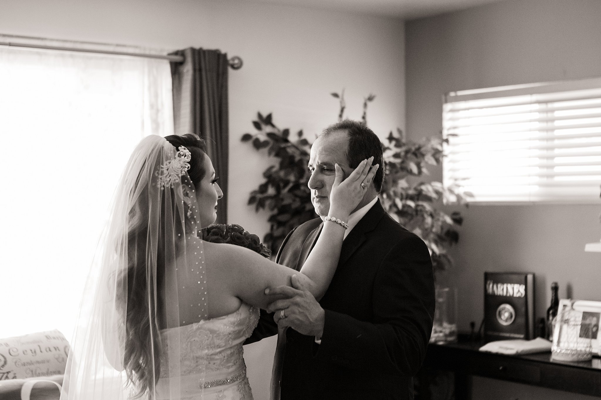 Father of the bride cries when he sees her for the first time as a bride.