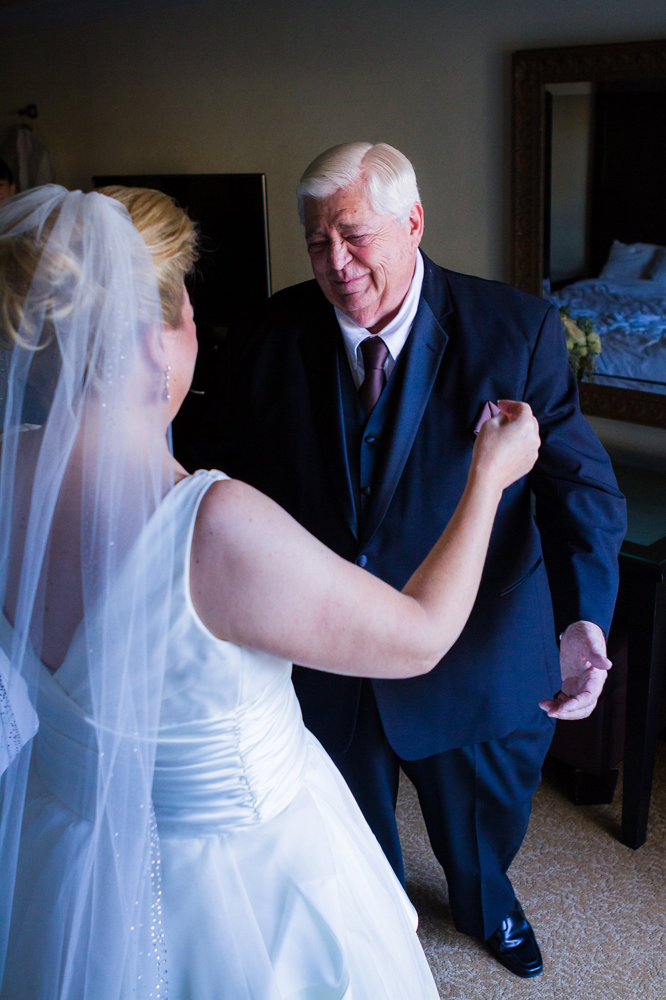 Emotional wedding photos. Bride does a first look with her elderly father and he starts to cry.