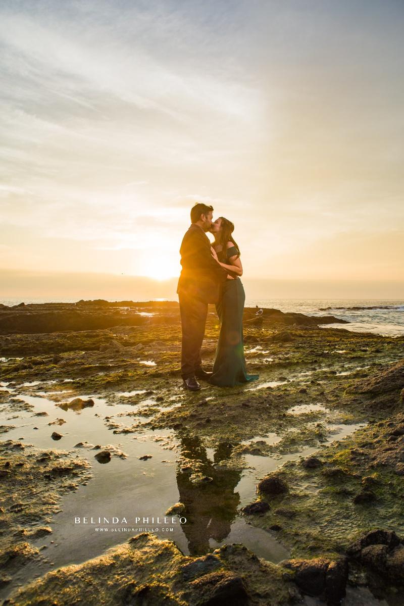 Romantic engagement photos at Laguna Beach during sunset