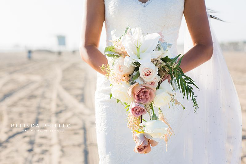 Soft and tropical bridal bouquet created by Serenade of Flowers in Orange County, CA. Photo by Belinda Philleo