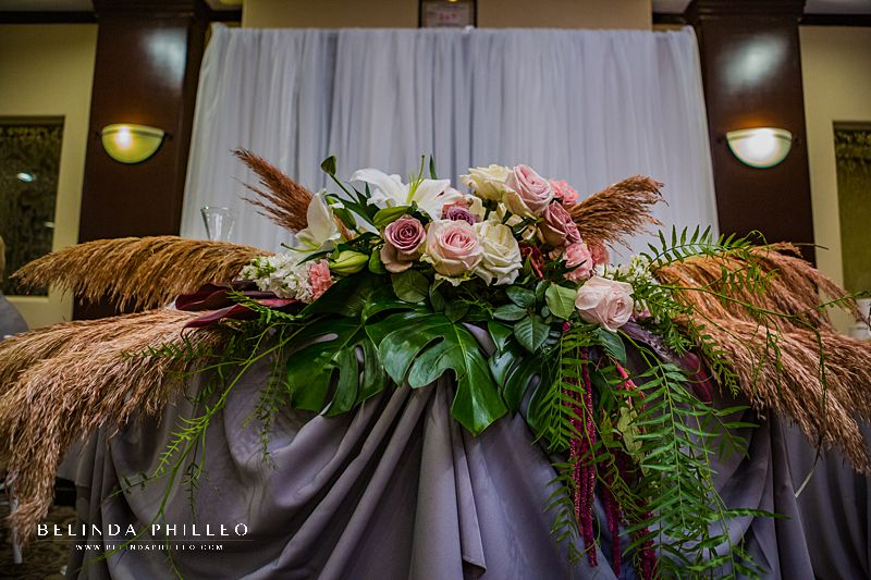 Tropical sweetheart table florals by Serenade of Flowers in Orange County, CA. Photo by Belinda Philleo