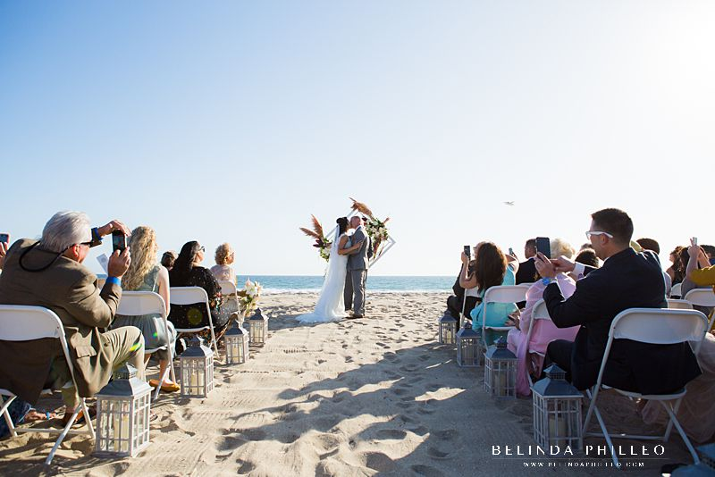 Bride and groom share first kiss at their intimate Huntington Beach wedding