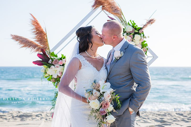 Romantic bride and groom portraits at Huntington Beach wedding