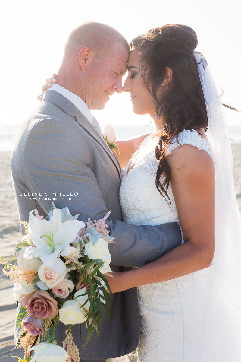 Bride and groom portraits at Huntington Beach wedding by Belinda Philleo