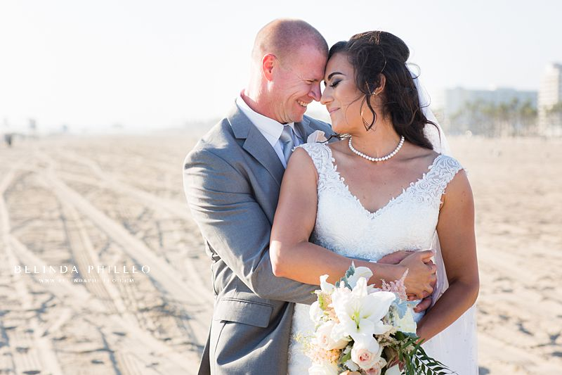 Bride and groom share a romantic moment after their Huntington Beach Wedding