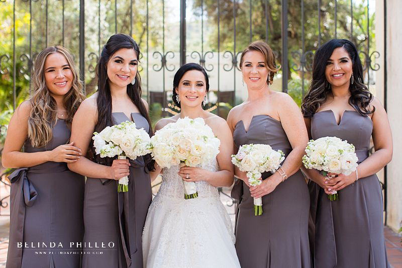 Bride and bridesmaids portrait. Bridesmaid gowns White by Vera wang v-wire crepe mermaid in Charcoal, Bride's gown Martina Liana Carmen + Sander style