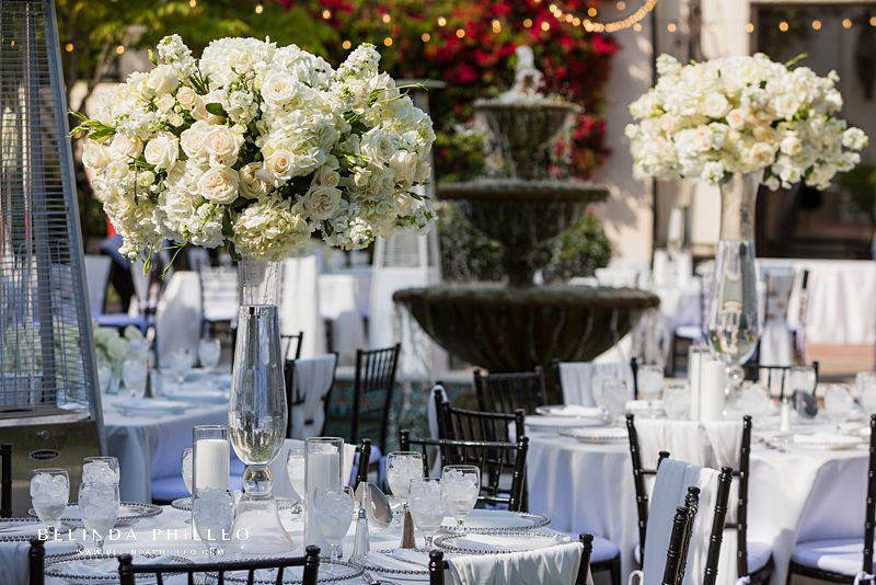 Tall all white floral centerpieces at Los Angeles River Center & Gardens Wedding
