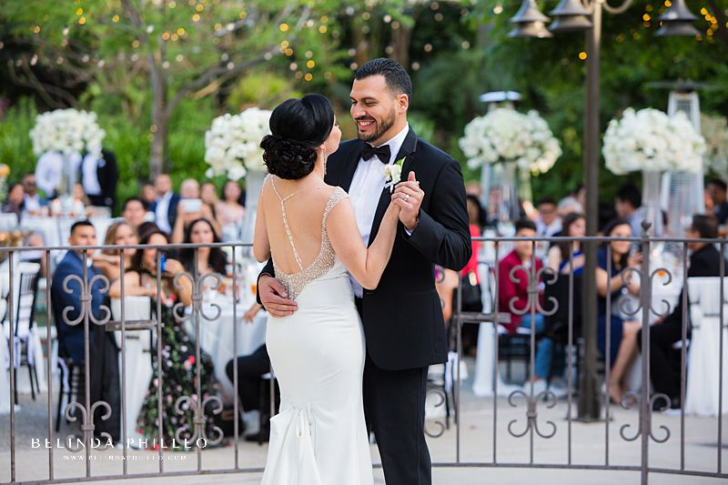 bride and groom share first dance at their Los Angeles River Center & Gardens wedding