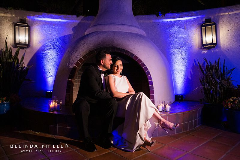 bride and groom snuggle in front of fireplace at Los Angeles River Center & Gardens wedding