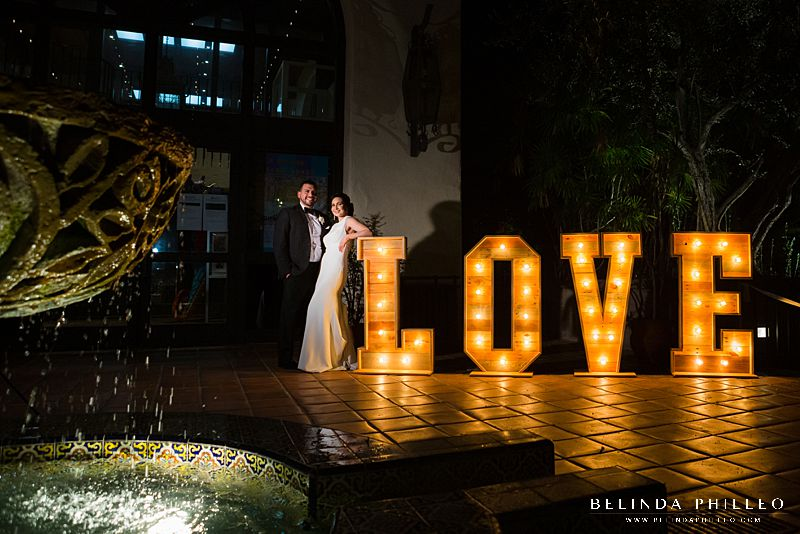 Bride and Groom pose next to Love Marquee at Los Angeles River Center and Gardens wedding