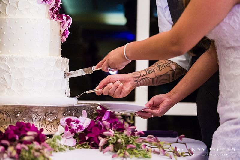Bride and groom cut their cake from Simply Irresistible Cakes & Catering at their Friendly Hills Country Club wedding