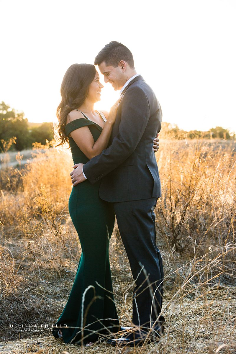 Bride-to-be and her fiance share a sweet moment during their Orange County engagement photo session with Photography by Belinda Philleo