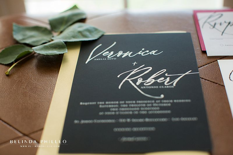 Black and gold wedding invitations made by Simply Stated Stationery