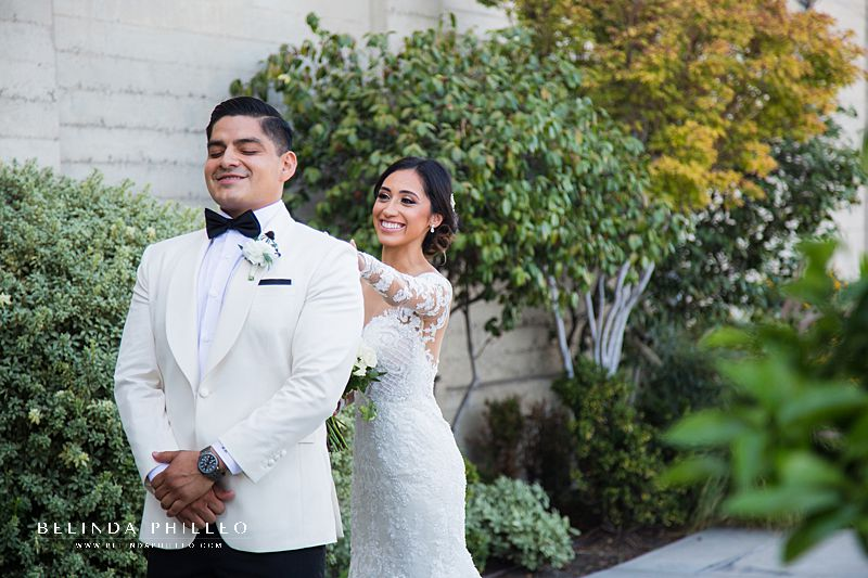 Bride and groom share intimate first look photos outside St John's Episcopal Cathedral in Downtown Los Angeles. Photography by Belinda Philleo