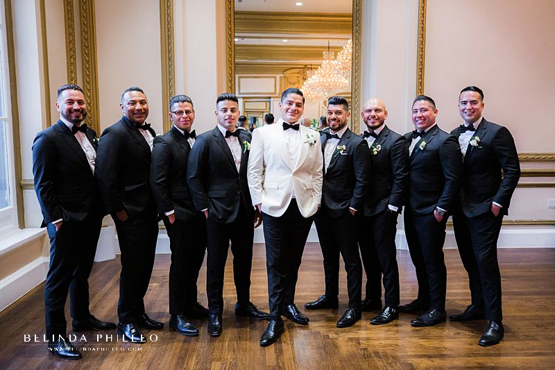 Black and white tuxes for glamorous wedding at Alexandria Ballroom in Los Angeles, CA