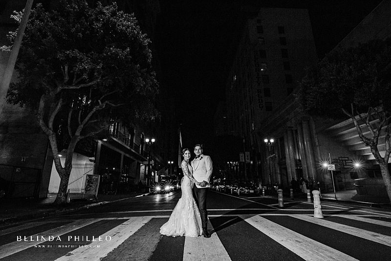 Bride and groom pose for night photos during their wedding at Alexandria Ballrooms in Downtown Los Angeles. Photo by Belinda Philleo
