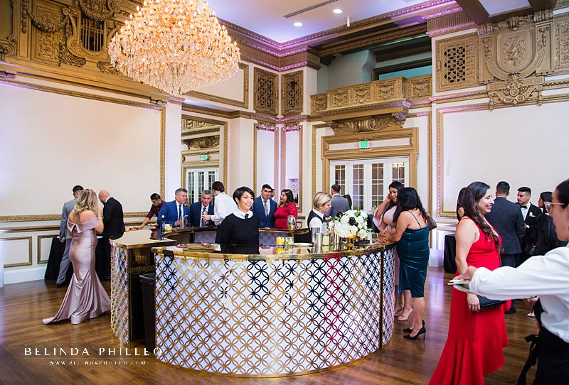 Ultra glamorous white and gold event bar at Alexandria Ballrooms wedding in Los Angeles, CA