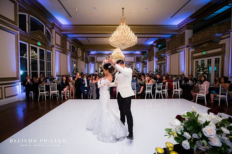 Bride and groom share their first dance during their wedding at Alexandria Ballrooms in Downtown LA. Photography by Belinda Philleo