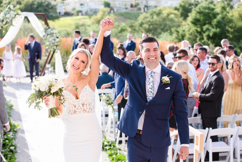 Newlyweds cheer in celebration at their Coto De Caza Golf Club Wedding, Orange County, CA