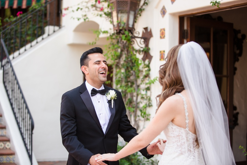 Bride and groom enjoy their first look at Hummingbird Nest Ranch wedding