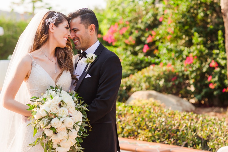 Newlyweds enjoy a sweet moment together at their Hummingbird Nest Ranch Wedding