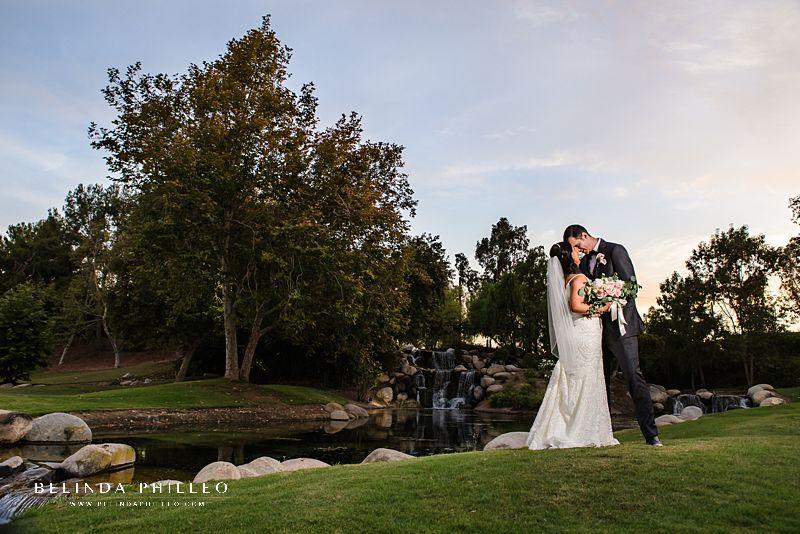 Coyote Hills Golf Club Wedding portraits near waterfall. Photography by Belinda Philleo